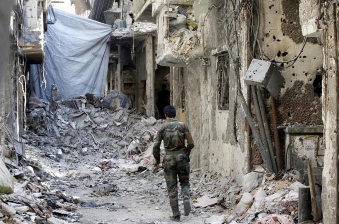 Palestinian fighters started to replace the armed rebels of Jabhat al-Nusra on Tuesday [File: AFP]