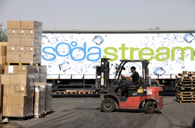 An employee uses a forklift truck to prepare pallets of SodaStream products for export at the SodaStream International Ltd. factory in Mishor Adumim, near Jerusalem, Israel. Photographer: Ariel Jerozolimski/Bloomberg