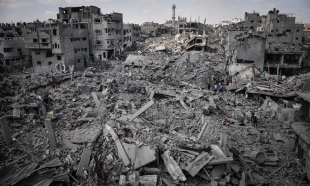 Mandatory Credit: Photo by Sipa USA/REX (4039032a) Palestinians inspect their destroyed homes in Shejaiya, Gaza which witnesses said was heavily hit by Israeli shelling and air strikes Israel - Gaza conflict, Gaza, Palestinian Territories - 04 Aug 2014